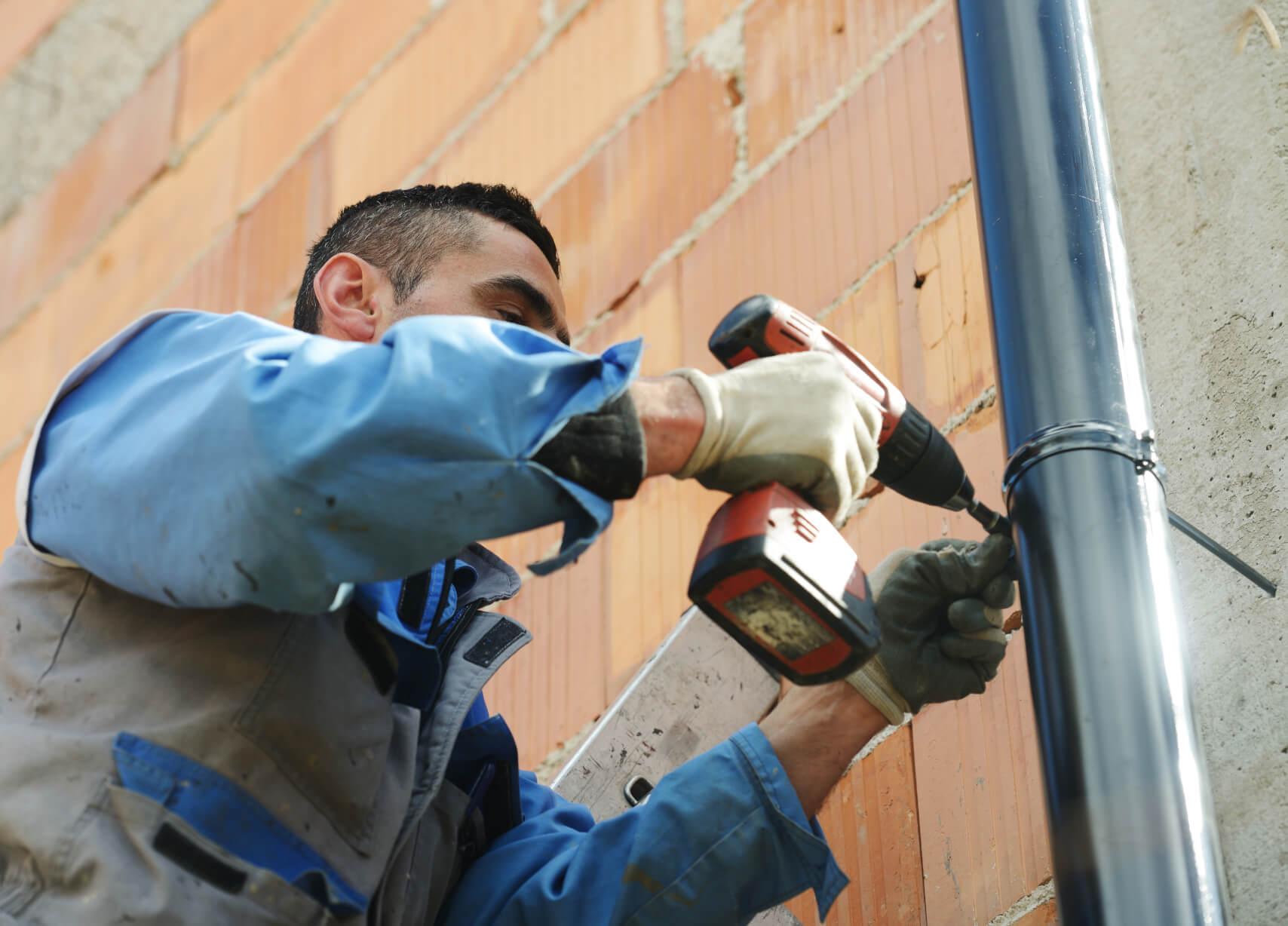 Facility Maintenance on Ladder